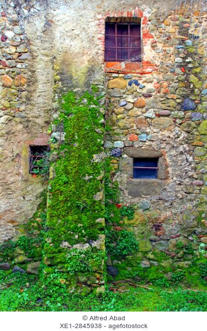 Windows in stone wall, Flaçà, Girona, Catalonia, Spain