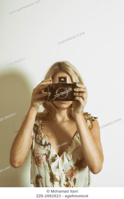 Woman holding a vintage camera